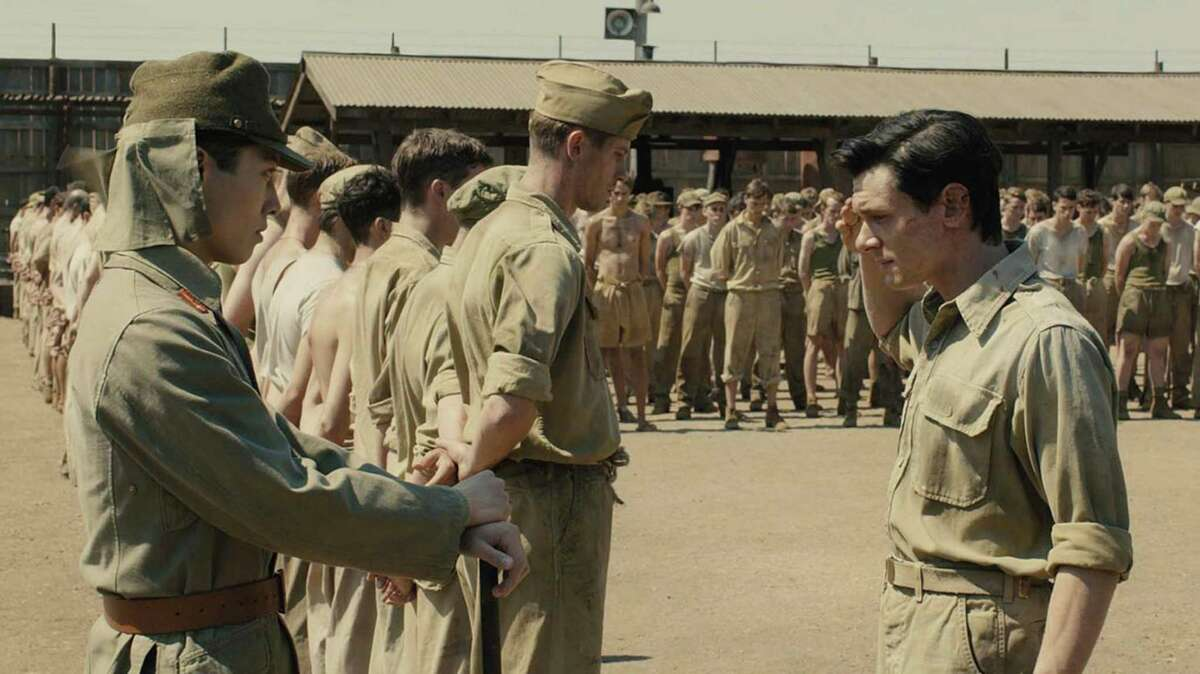 Jack O'Connell portrays Olympian and war hero Louis Zamperini, who was imprisoned in a Japanese prison camp, in