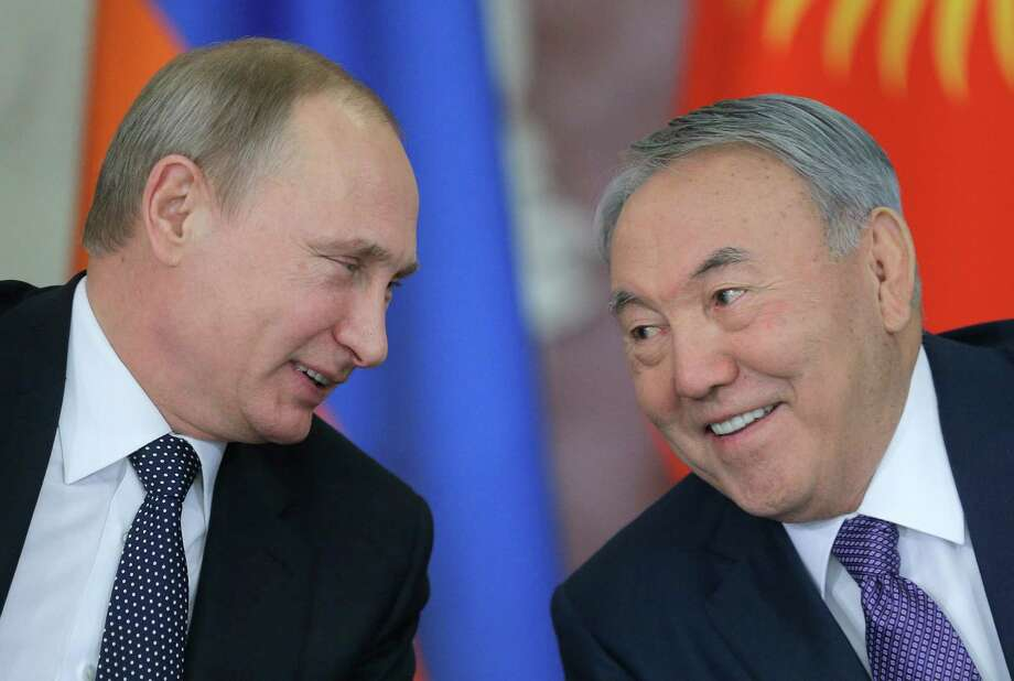 Russian President Vladimir Putin, left, talks with Kazakhstan's President Nursultan Nazarbayev during the Eurasian Economic Union summit in Moscow's Kremlin, Russia, Tuesday, Dec. 23, 2014. Putin, Lukashenko and leaders of Kazakhstan, Kyrgyzstan and Armenia finalized the creation of the Eurasian Economic Union, a new alliance intended to boost their economic integration. (AP Photo/ Maxim Shipenkov, Pool) Photo: Maxim Shipenkov / Associated Press / EPA POOL