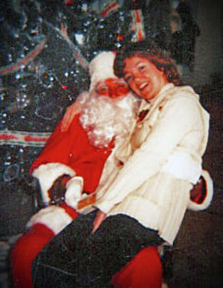 Patricia Allen, now principal of Parkway School in Greenwich, with her father during a visit Santa Claus made to her former school in Massachussetts. Photo: Contributed Photo / Greenwich Time Contributed