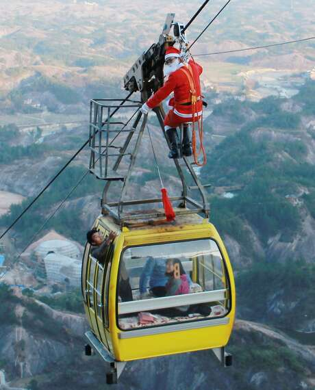 In Yueyang, in China's central Hunan province, a Santa delivers gifts to gondola riders. Photo: Str, AFP/Getty Images