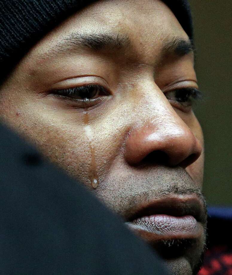 Dameion Perkins, Dontre Hamilton's brother, cries on the steps of the federal courthouse Monday after learning that Milwaukee County District Attorney John Chisholm decided that there would be no charges against former police office Christopher Manney in the fatal shooting of Hamilton. Photo: Morry Gash / Associated Press / AP