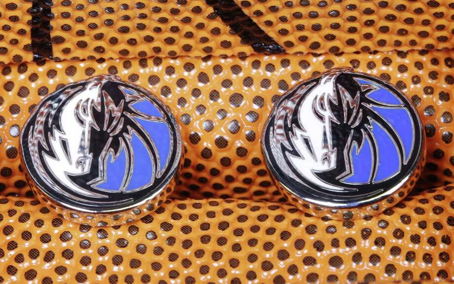 Dallas Mavericks cuff links are among some of the hundreds of Cufflinks.com's specialty designs. Photo: David Woo / McClatchy-Tribune News Service / Dallas Morning News