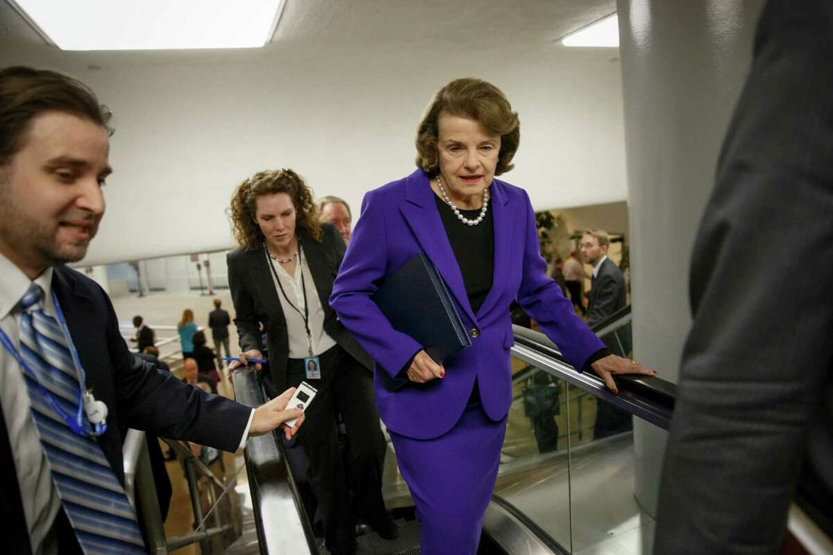 Senate Intelligence Committee Chair Sen. Dianne Feinstein, D-Calif. is pursued by reporters on Capitol Hill in Washington, Tuesday, Dec. 9, 2014, as she arrives to release a report on the CIA's harsh interrogation techniques at secret overseas facilities after the 9/11 terror attacks. (AP Photo/J. Scott Applewhite)