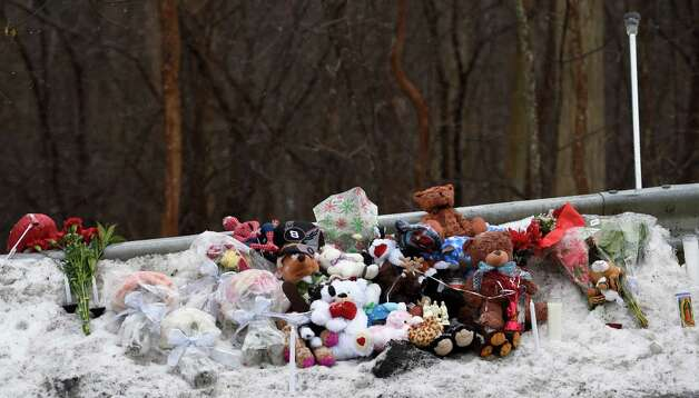 Objects were cleared from a roadside memorial for Kenneth White, who was killed in December 2014, so they wouldn't be swept away by snow plows, according to Albany County Sheriff Craig Apple. Members of a group called Kenneth's Army stored the items for safekeeping and left a note at the site. (Skip Dickstein/Times Union archive) Photo: SKIP DICKSTEIN / 00029971A