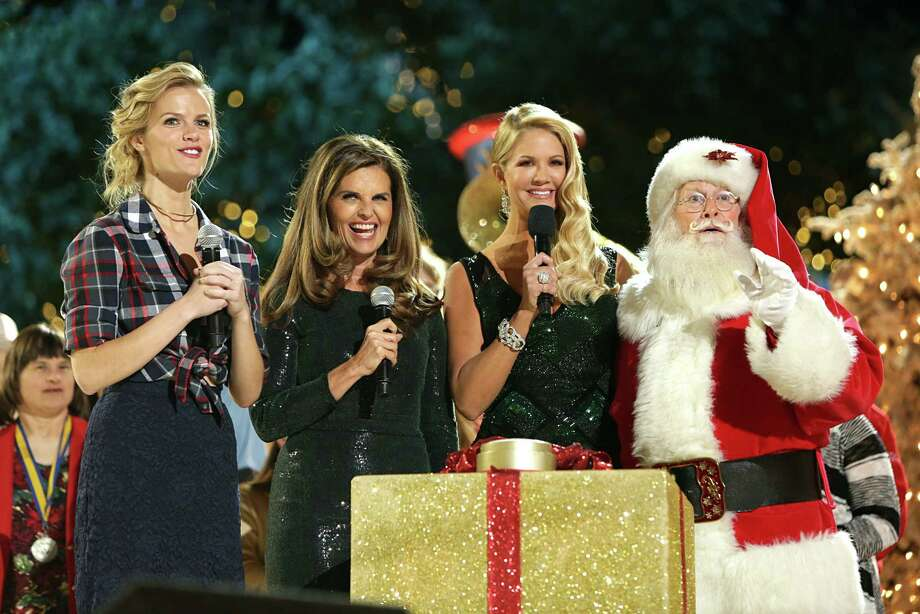 Santa with TV personality Nancy O'Dell (from left), Maria Shriver and model/actress Brooklyn Deckerat The Grove's 12th Annual Christmas Tree Lighting Spectacular Presented By Citi at The Grove in Los Angeles, Calif.,on Nov. 16, 2014. Photo: Tiffany Rose, Getty Images / 2014 Tiffany Rose