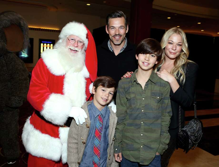 Santa with actor Eddie Cibrian, singer LeAnn Rimes, and their children Jake Cibrian (left) and Mason Cibrian (right), at The Grove's 12th Annual Christmas Tree Lighting Spectacular Presented By Citi at The Grove in Los Angeles, Calif., on Nov. 16, 2014. Photo: Tiffany Rose, Getty Images / 2014 Tiffany Rose