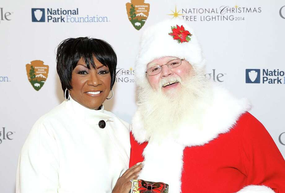 Santa with singer Patti LaBelle at the 2014 National Christmas Tree Lighting Ceremony at President's Park in Washington, D.C., on Dec. 4, 2014. Photo: Paul Morigi, Getty Images / 2014 Paul Morigi