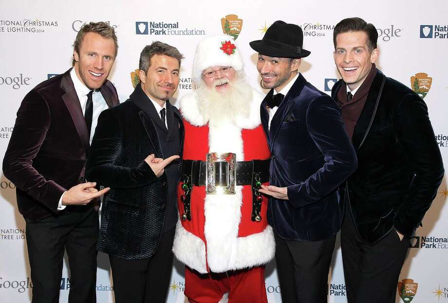 Santa with singers The Tenors — Fraser Walters (from left), Remigio Pereira, Victor Micallef and Clifton Murray — at the 2014 National Christmas Tree Lighting Ceremony at President's Park  in Washington, D.C., on Dec. 4, 2014. Photo: Paul Morigi, Getty Images / 2014 Paul Morigi