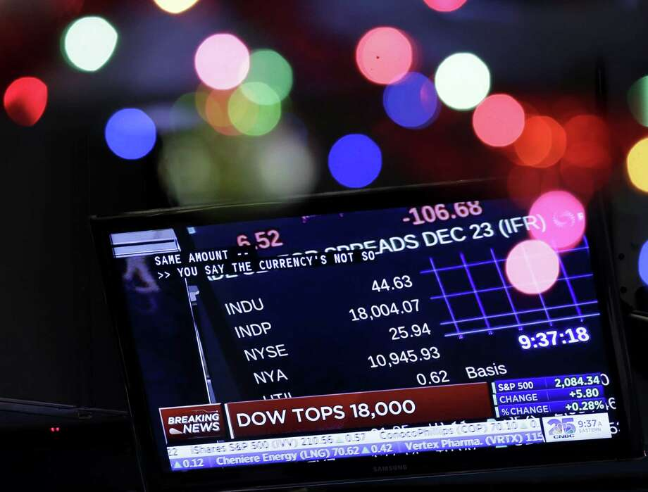 A TV displays the Dow Jones industrial average above 18,000 on the floor of the New York Stock Exchange on Tuesday. Photo: Seth Wenig / Associated Press / AP