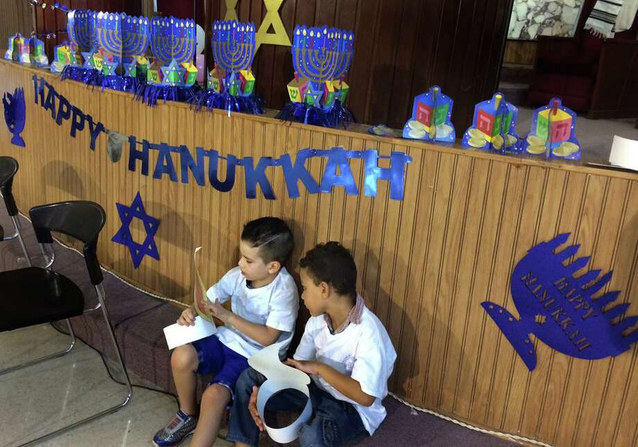 Children with paper likenesses of candle flames are among Cubans celebrating Hanukkah at Temple Beth Shalom in Havana. Photo: Tracy Wilkinson / McClatchy-Tribune News Service / Los Angeles Times
