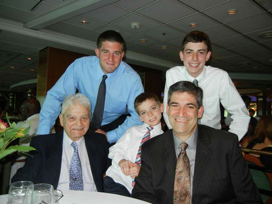 This July photo provided by Joseph Vaglio, right, shows his father Pasquale Vaglio, left, and his grandchildren on board a Royal Caribbean's cruise ship. Photo: Joseph Vaglio / Associated Press / Joseph Vaglio
