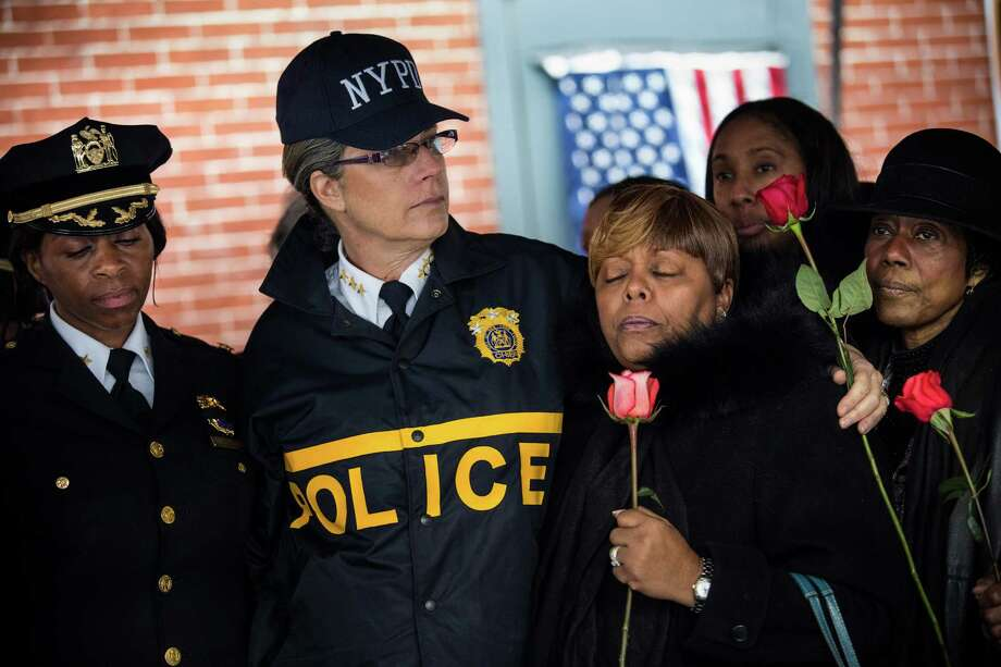 NYPD Bureau Chief Joanne Jaffe (center) meets with a group that works to end violence after a memorial for two slain officers. Photo: Andrew Burton / Getty Images / 2014 Getty Images