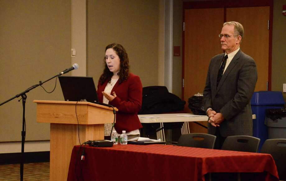Michelle Miller and Bill Silver, of the architecture and engineering firm Silver/Petrucelli and Associates, present a facilities capital needs assessment to the Board of Education during a meeting Monday night, Dec. 22, 2014, at New Canaan High School, New Canaan, Conn. Photo: Nelson Oliveira / New Canaan News