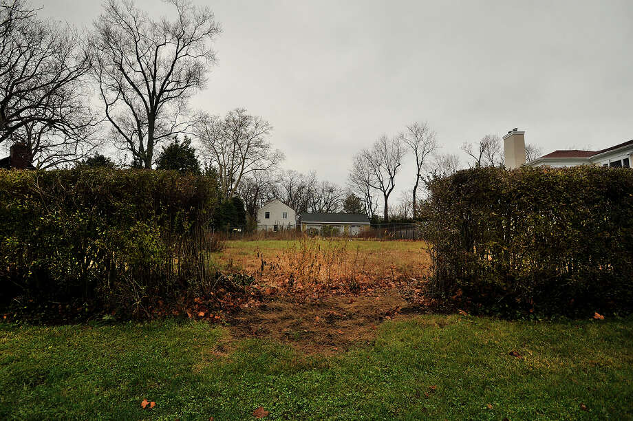 An empty lot sits vacant at the end of Shippan Avenue in Stamford, Conn., on Tuesday, Dec. 23, 2014. The lot is all that remains after a fire swept through a house there and killed three children and two adults on Christmas Day in 2011. Photo: Jason Rearick / Stamford Advocate