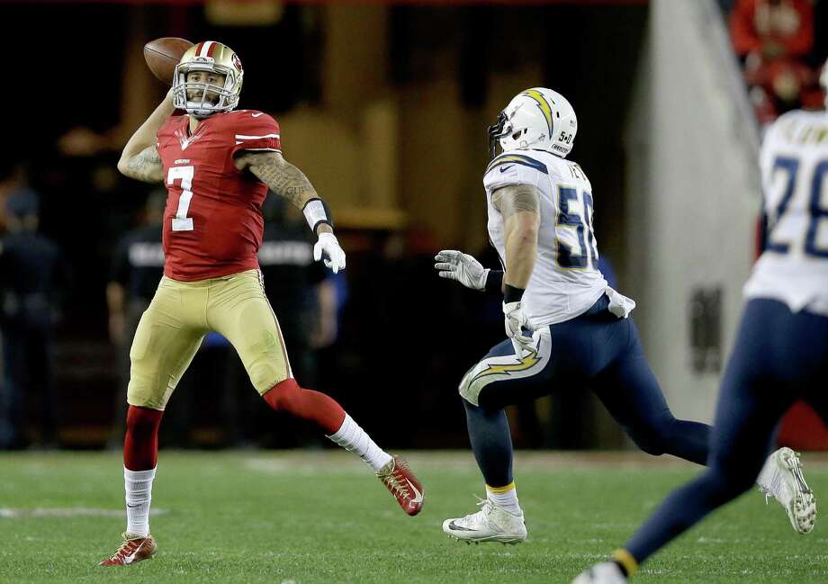 Colin Kaepernick (7) indicates he'll enlist a quarterback consultant this offseason to fix his mechanics. Photo: Ezra Shaw / Getty Images / 2014 Getty Images