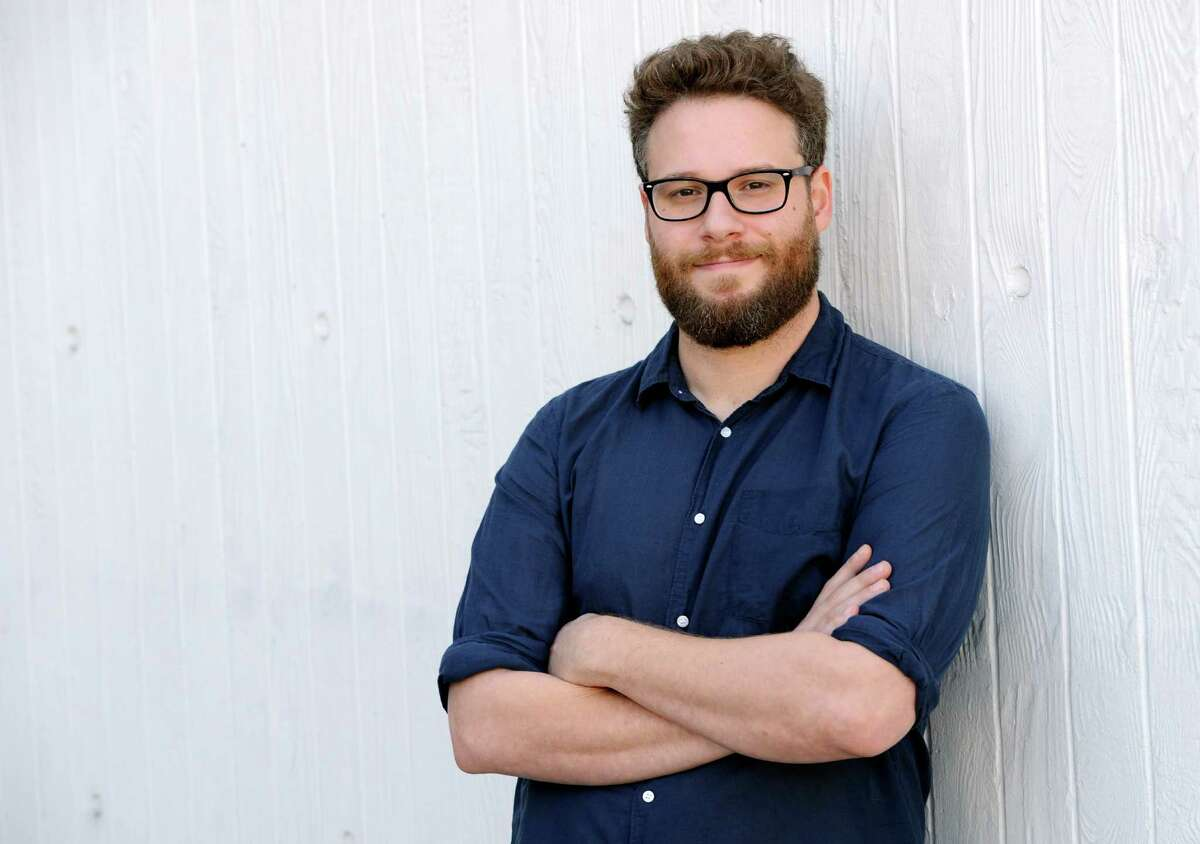 """FILE- In this Oct. 13, 2014 file photo, actor/co-writer and co-director, Seth Rogen of the film """"The Interview,"""" poses for a portrait in Los Angeles. After a hacking attack on Sony Pictures and threats of terrorist attacks when ?""""The Interview?"""" was set to open in theaters on Christmas Day, Sony canceled the release of Rogen?'s film on Wednesday, Dec. 17, 2014. Sony Pictures Entertainment announced Tuesday a limited theatrical release of ?""""The Interview?"""" beginning Thursday, putting back into the theaters the comedy that prompted an international incident with North Korea and outrage over its cancelled release. (Photo by Chris Pizzello/Invision/AP, File)"""