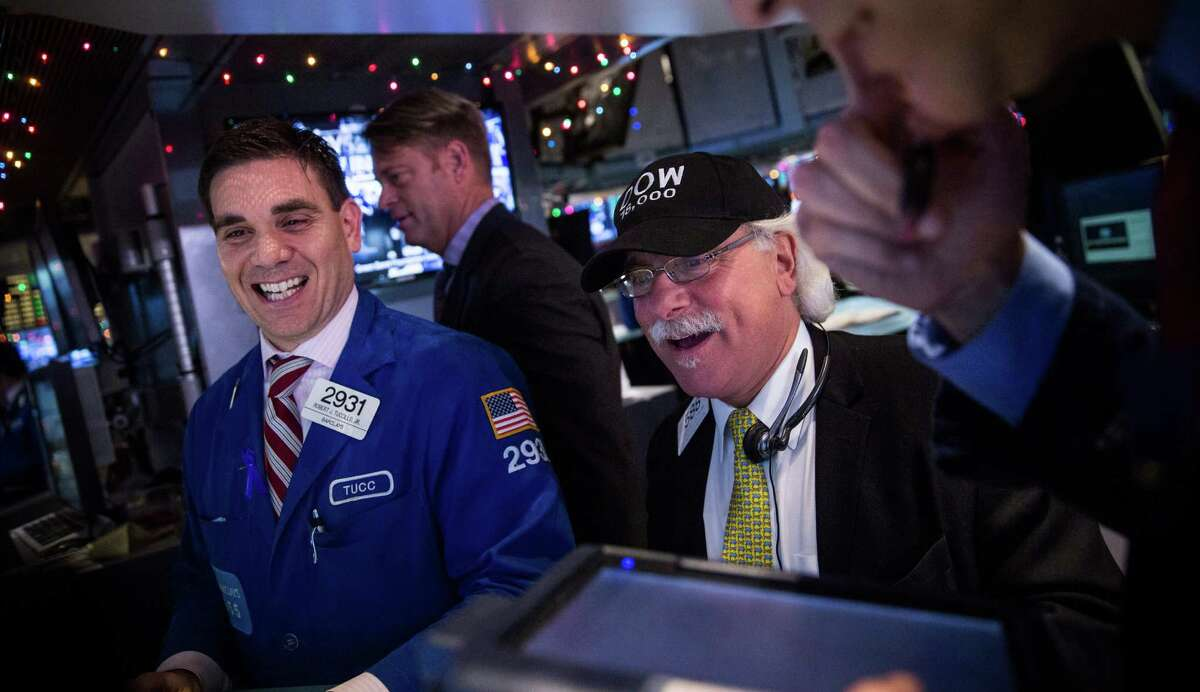 NEW YORK, NY - DECEMBER 23: Traders wear hats that say