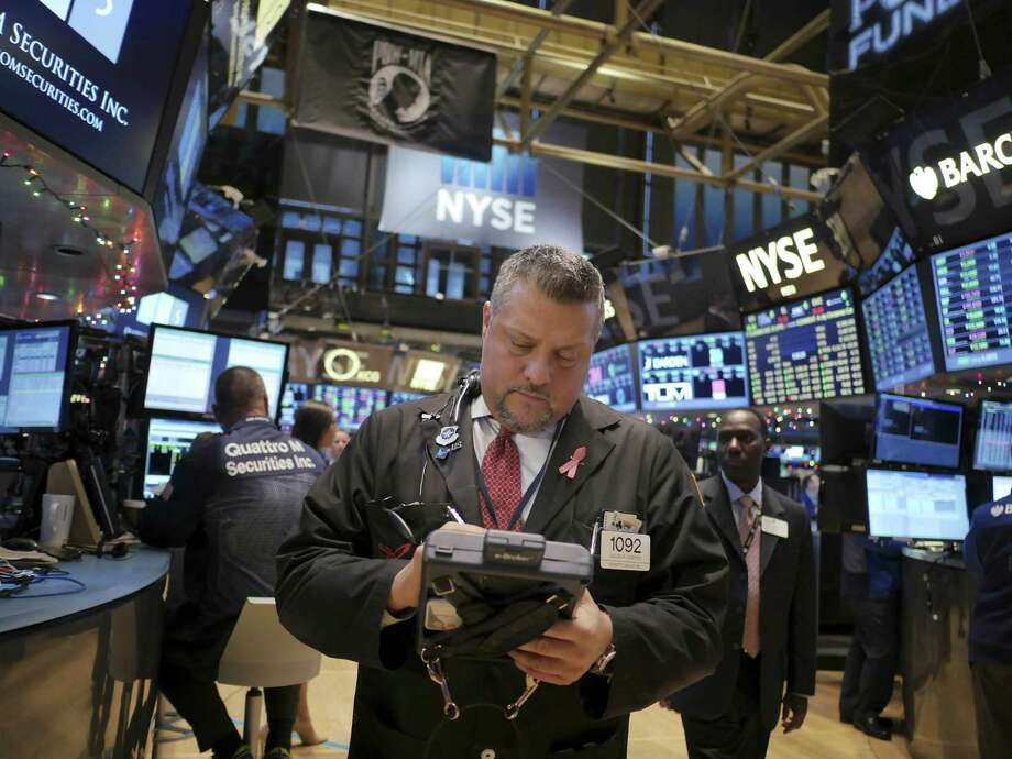 Traders work on the floor at the New York Stock Exchange, in New York. (AP Photo/Seth Wenig) ORG XMIT: NYSW106 Photo: Seth Wenig / AP