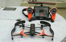 Drones like the Parrot Bebop, shown with its Sky controller, have taken off as popular holiday gifts.