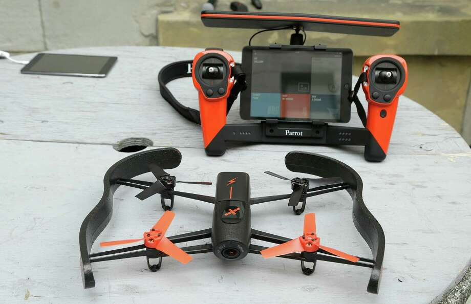 Drones like the Parrot Bebop, shown with its Sky controller, have taken off as popular holiday gifts. Photo: Jeff Chiu / Associated Press / AP