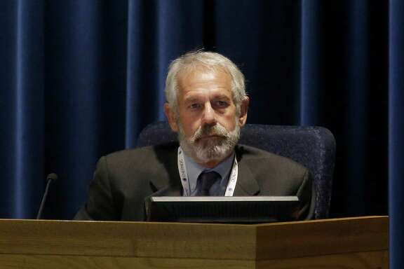 California Public Utilities Commissioner Michael Picker listens to speakers during a meeting of the five-member commission in San Francisco, Thursday, Dec. 18, 2014. (AP Photo/Jeff Chiu)
