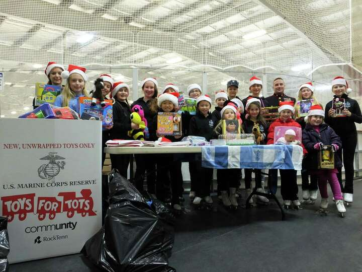 Children with Saratoga Synchronized Skating provided dozens of new, unwrapped toys to officials with