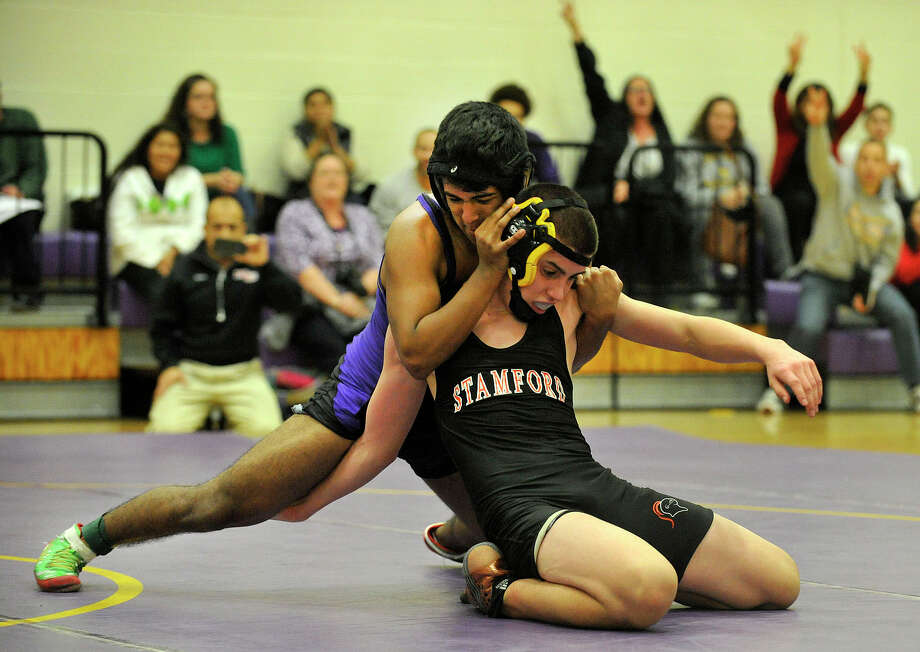 Stamford's Nicholas Lucente wrestles Westhill's Jessy Pedraza during their 138-pound weight class bout at Westhill High School in Stamford, Conn., on Tuesday, Dec. 23, 2014. Westhill won the match, 54-18. Photo: Jason Rearick / Stamford Advocate