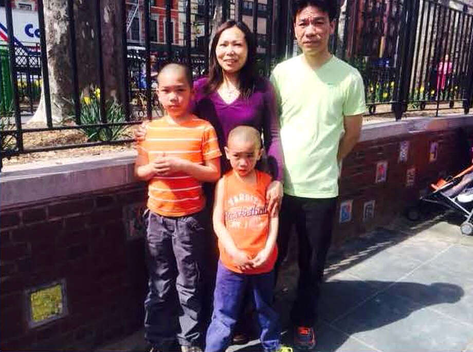 Click through for a series of unsolved cases in the Capital Region. Hai Yan Li, left, and Jin Chen and their sons Anthony, 10, and Eddy, 7, were found dead inside their Western Avenue home in Guilderland on Oct. 8, 2014. (Photo provided by State Police)