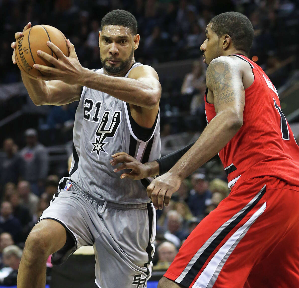 Tim Duncan turns to the hoop against LaMarcus Aldridge in overtime as the Spurs host the Portland Trailblazers at the AT&T Center on December 19, 2014.
