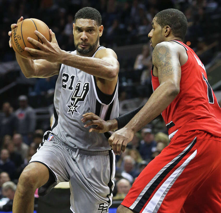 Tim Duncan turns to the hoop against LaMarcus Aldridge in overtime as the Spurs host the Portland Trailblazers at the AT&T Center on December 19, 2014. Photo: Tom Reel /San Antonio Express-News