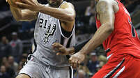 Tim Duncan turns to the hoop against LaMarcus Aldridge in overtime as the Spurs host the Portland Trail Blazers at the AT&T Center on Dec.19, 2014.