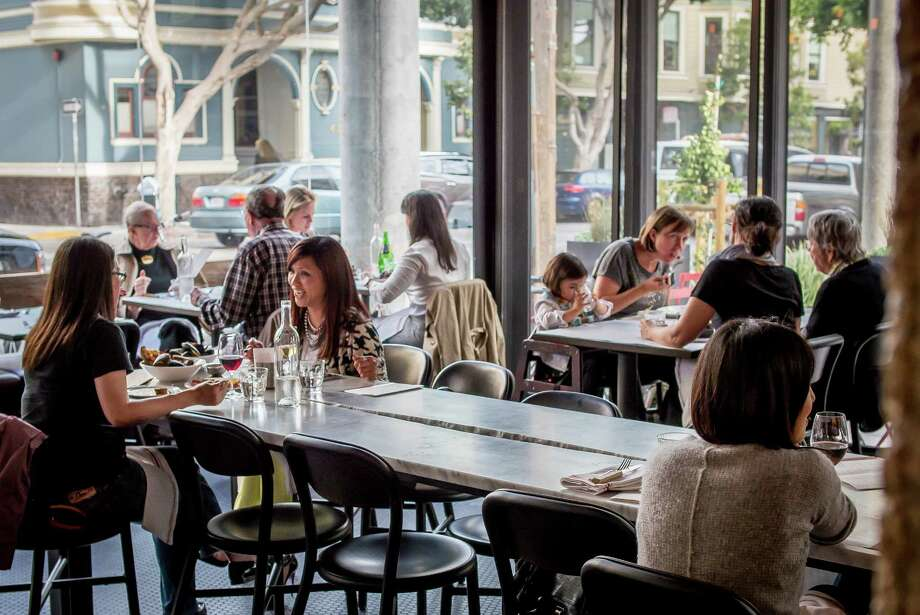 Monsieur Benjamin's interior has an open, contemporary vibe, with windows on two sides, and a bar and open kitchen in the middle. Photo: John Storey / Special To The Chronicle / ONLINE_YES