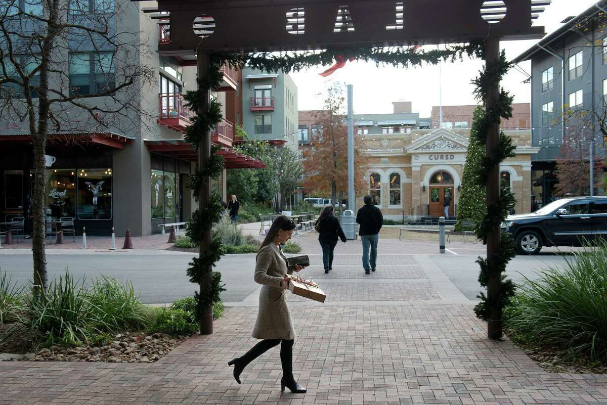 Lauren Wood walks away from shops at the Pearl with a last-minute gift for her boyfriend on Tuesday, December 23, 2014.