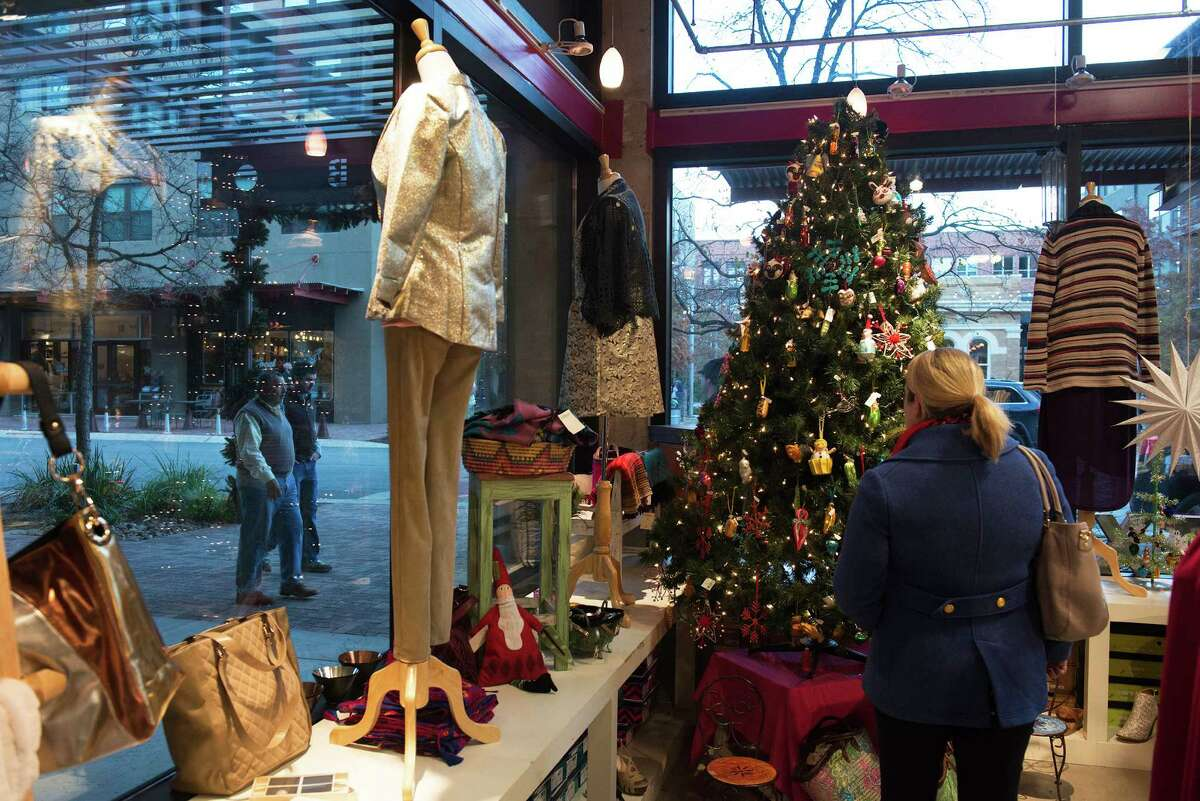 Shoppers look for presents inside the shop Adelante at the Pearl on Tuesday, December 23, 2014.
