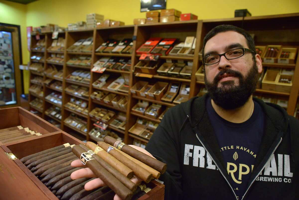 Gabriel Garcia is the owner of Cigar Pointe. He is anticipating a demand for Cuban cigars. He displays some of the finer cigars in his inventory on Tuesday, Dec. 23, 2014.