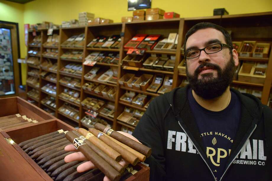 Gabriel Garcia is the owner of Cigar Pointe. He is anticipating a demand for Cuban cigars. He displays some of the finer cigars in his inventory on Tuesday, Dec. 23, 2014. Photo: Billy Calzada, San Antonio Express-News /  San Antonio Express-News
