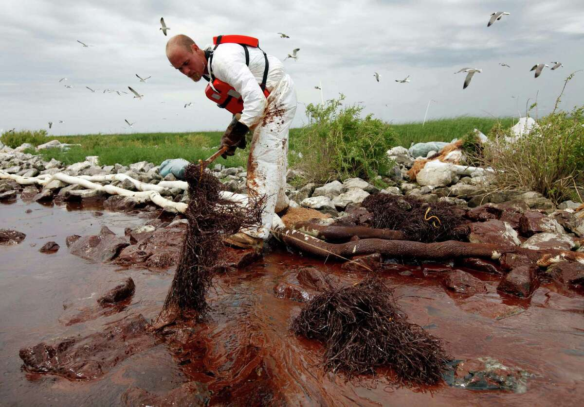 Oil washed ashore in Plaquemines Parish, Louisiana, and elsewhere on the coast after BP's Macondo subsea well blew out in the Gulf of Mexico in April 2010. (AP Photo/Gerald Herbert, File)