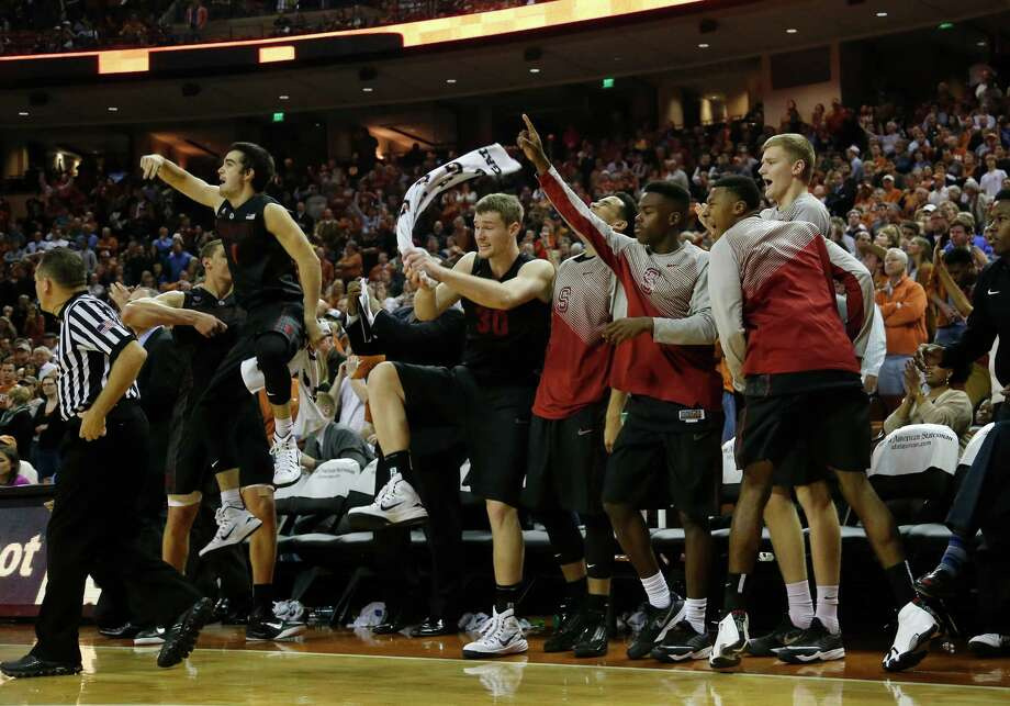 Stanford celebrates its 74-71 upset victory over No. 9 Texas in overtime. Photo: Chris Covatta / Getty Images / 2014 Getty Images