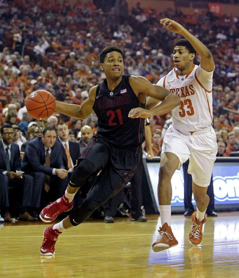 Stanford guard Anthony Brown (21) drives around Texas forward Jordan Barnett (33) during the first half of an NCAA college basketball game, Tuesday, Dec. 23, 2014, in Austin, Texas. (AP Photo/Michael Thomas) Photo: Michael Thomas / Associated Press / FR65778 AP
