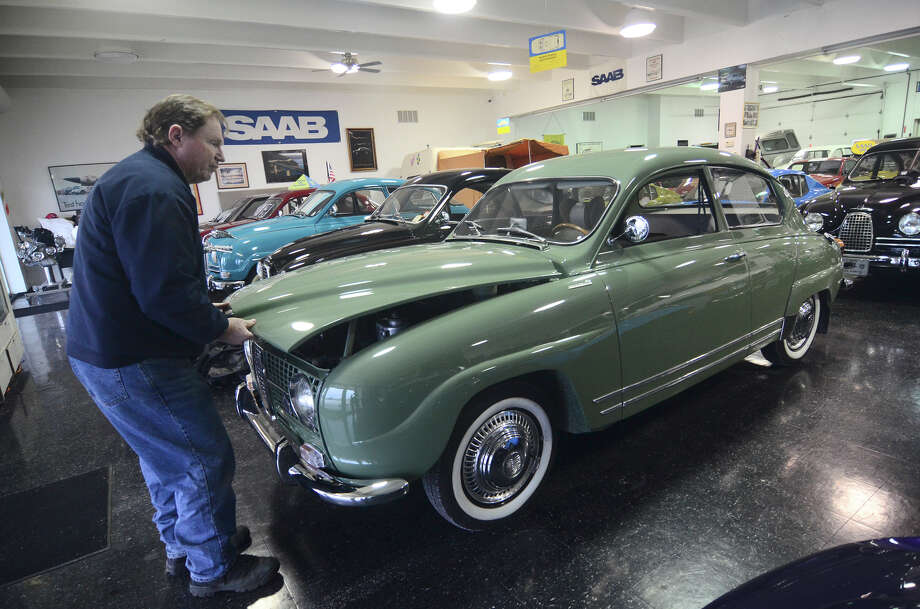 Tom Donney pops the trunk of his Saab Monte Carlo in his Fort Dodge, Iowa, showroom. He loaned it to Jerry Seinfeld for a shoot in Portland, Ore. Photo: Jesse Major / Associated Press / The Messenger