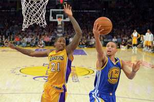 Warriors flat in loss to Kobe-less Lakers - Photo
