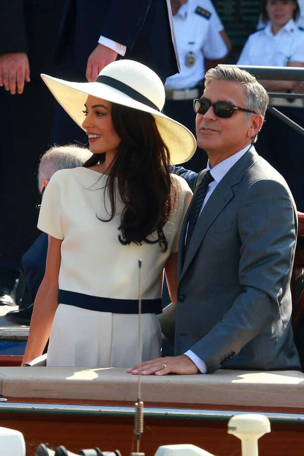 "NICE: George Clooney and Amal Alamuddin. From their completely tasteful Venetian wedding to the happiness  that two accomplished, socially aware, mature adults coming together brings (as good-looking as they both are, neither one of them is a ""trophy spouse"") this couple is at the top of Santa's ""nice"" list. Long may they, the anti-Kim and Kanye, reign. Photo: Robino Salvatore, GC Images"