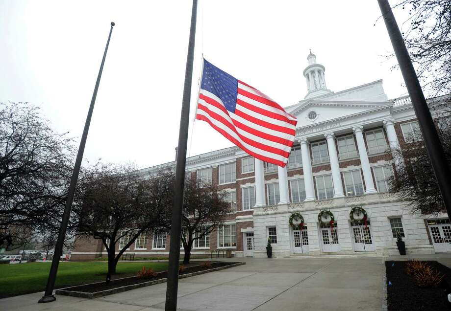 The American flag flown at half-staff at Greenwich Town Hall, Wednesday morning, Dec. 24, 2014, to honor Greenwich Selectman David Theis who passed away unexpectedly on Tuesday. Photo: Bob Luckey / Greenwich Time