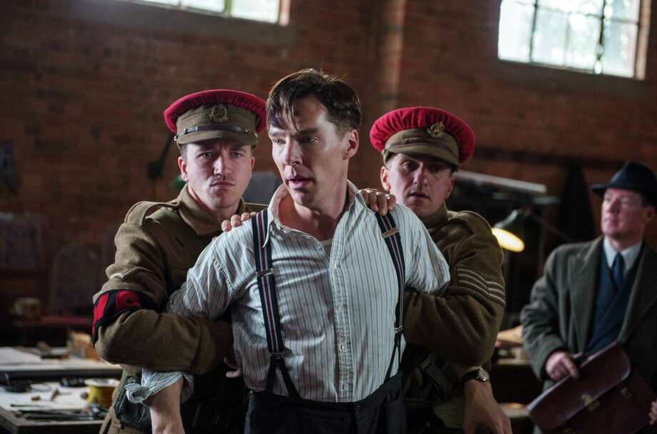 "In this image released by The Weinstein Company, Benedict Cumberbatch, center, appears in a scene from ""The Imitation Game.""  The film was nominated for a Golden Globe for best drama on Thursday, Dec. 11, 2014. The 72nd annual Golden Globe awards will air on NBC on Sunday, Jan. 11. (AP Photo/The Weinstein Company, Jack English) Photo: Jack English, HONS / Associated Press / The Weinstein Company"