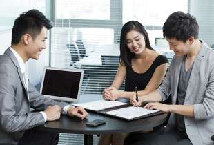 Young couple with financial consultant