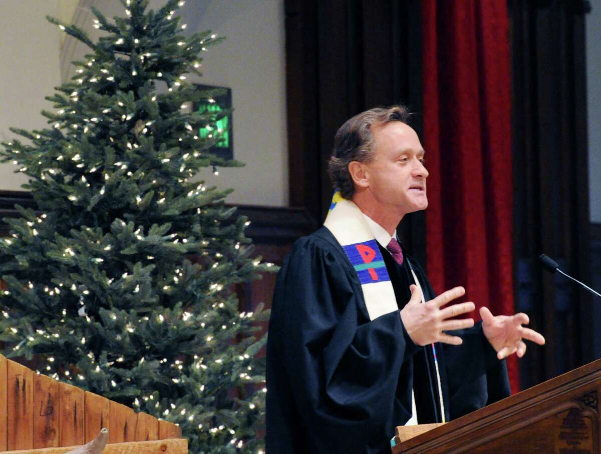 The Rev. Richard DenUyl, Jr., spoke during the Children's Christmas Eve service at the First Congregational Church in Old Greenwich, Conn., Wednesday, Dec. 24, 2014. The service featured a Nativity Pageant, a performance by the Cherub Choir as well as gifts from the congregation wrapped in white to be donated to families in need.