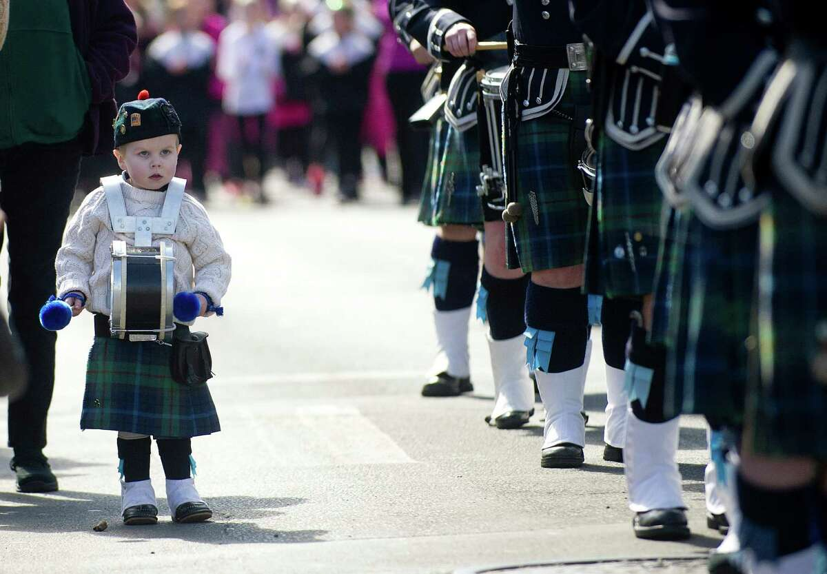 A young boy marches alongside a pipe band in the 19th annual St. Patrick's Day parade in Stamford, Conn., on Saturday, March 8, 2014.