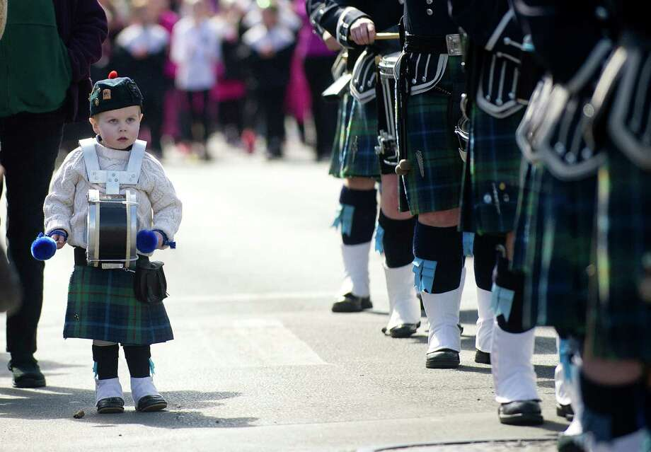A young boy marches alongside a pipe band in the 19th annual St. Patrick's Day parade in Stamford, Conn., on Saturday, March 8, 2014. Photo: Lindsay Perry / Stamford Advocate