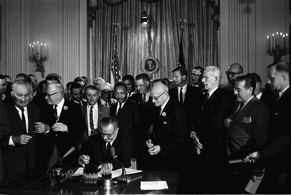 President Lyndon B. Johnson with civil rights leader Martin Luther King Jr.