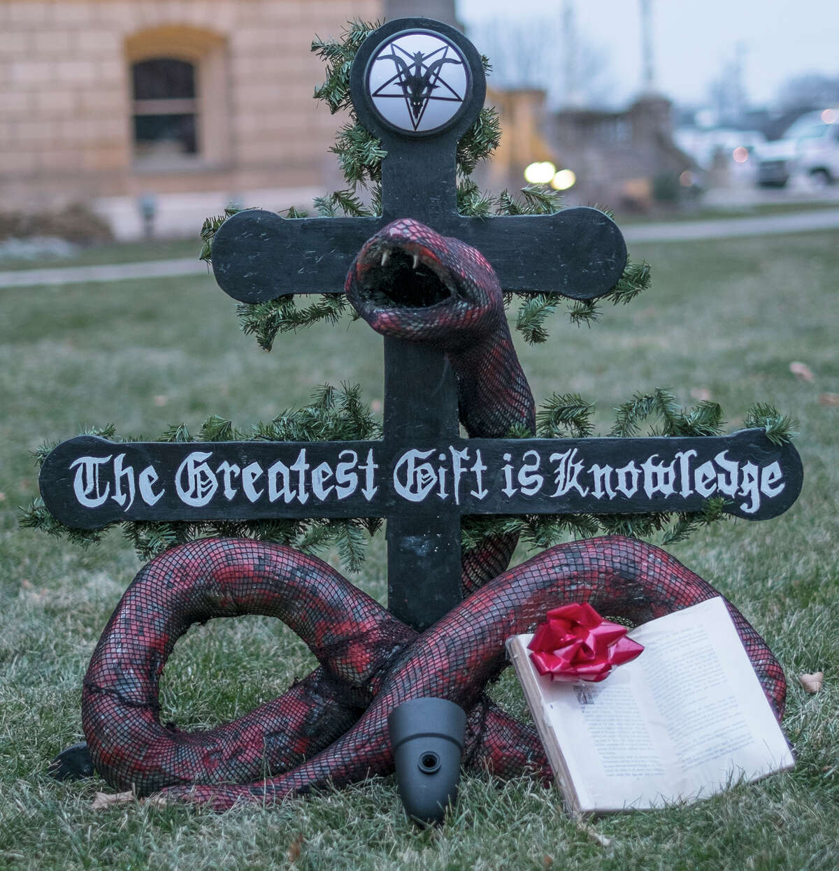 """A """"Snaketivity"""" scene featuring a snake offering a book called """"Revolt of the Angels"""" as a gift, as displayed on the grounds of the Capitol in Lansing, Mich., before Christmas 2014."""